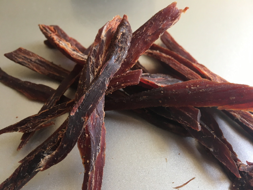fine slices of fresh homemade jerky, teriyaki flavored